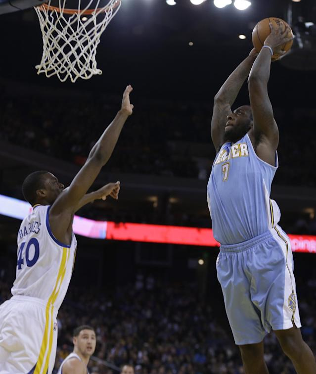 Denver Nuggets' J.J. Hickson, right, shoots over Golden State Warriors' Harrison Barnes (40) during the second half of an NBA basketball game on Wednesday, Jan. 15, 2014, in Oakland, Calif. (AP Photo/Ben Margot)