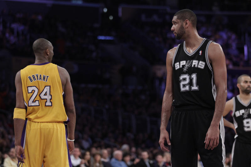 Los Angeles Lakers shooting guard Kobe Bryant and San Antonio Spurs center Tim Duncan during the first half of an NBA basketball game in Los Angeles, Thursday, Feb. 3, 2011. (AP Photo/Jae C. Hong)