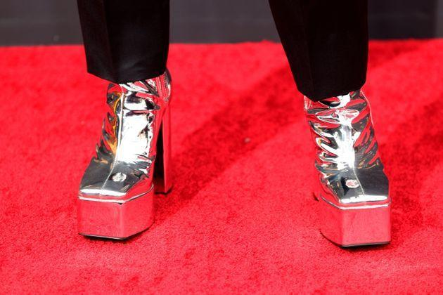 Bowen Yang wore silver platform heels by Syro. (Photo: Rich Fury via Getty Images)