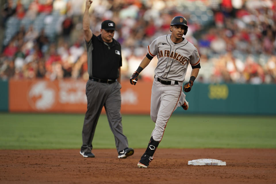 San Francisco Giants' Mauricio Dubon rounds the bases after a solo home run during the second inning of a baseball game against the Los Angeles Angels Tuesday, June 22, 2021, in Anaheim, Calif. (AP Photo/Marcio Jose Sanchez)