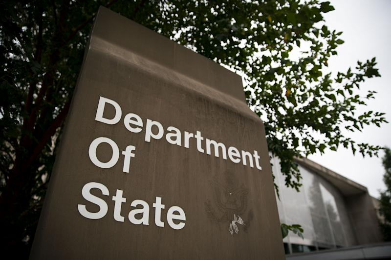 Signage is displayed outside the U.S. State Department headquarters in Washington, Oct. 3, 2019. (Photo: Al Drago/Bloomberg via Getty Images)