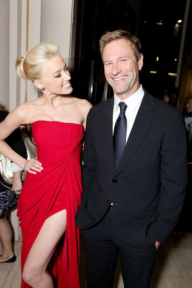 """<a href=""""http://movies.yahoo.com/movie/contributor/1809059761"""">Amber Heard</a> and <a href=""""http://movies.yahoo.com/movie/contributor/1800022565"""">Aaron Eckhart</a> at the Los Angeles premiere of <a href=""""http://movies.yahoo.com/movie/1810077951/info"""">The Rum Diary</a> on October 13, 2011."""