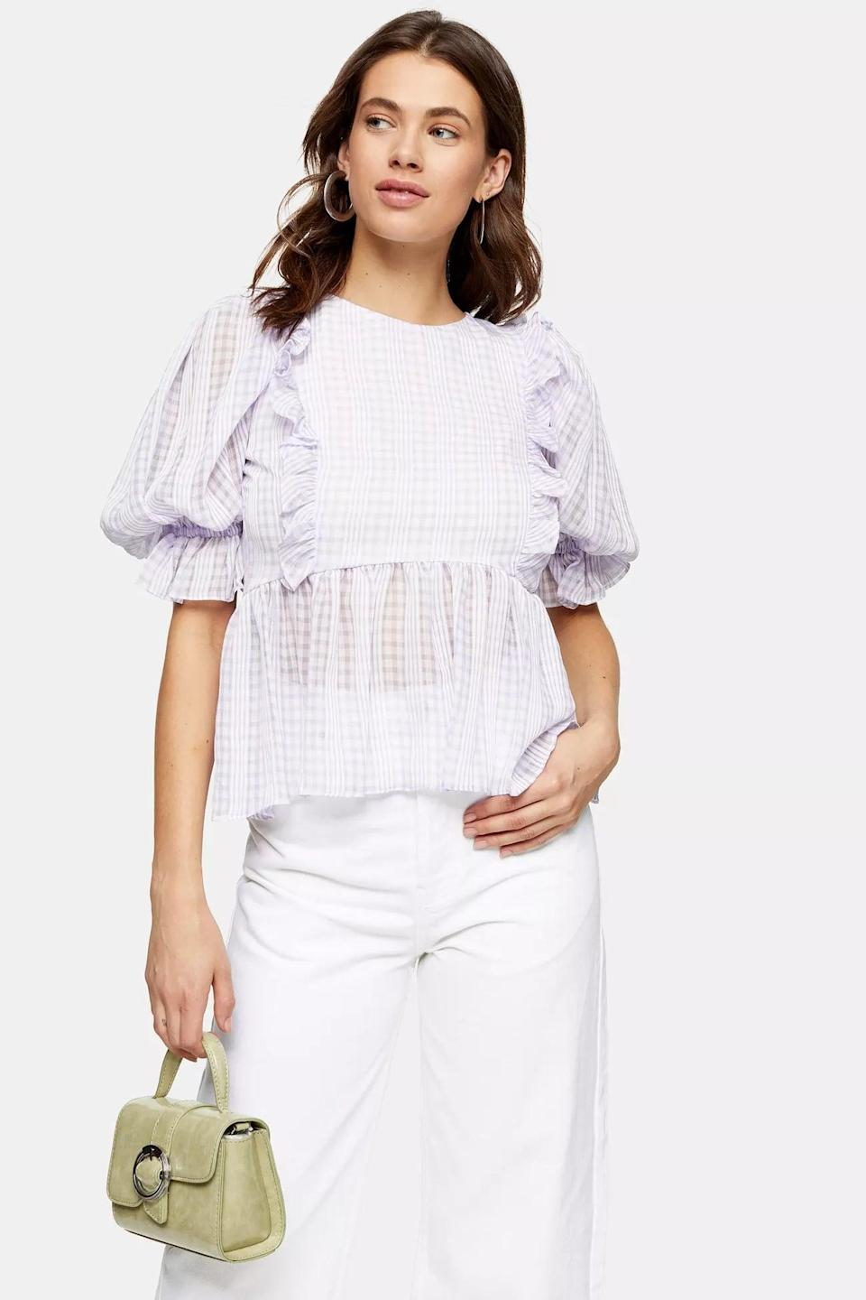 """<p>This <a href=""""https://www.popsugar.com/buy/Topshop-Lilac-Gingham-Puff-Sleeve-Blouse-583880?p_name=Topshop%20Lilac%20Gingham%20Puff%20Sleeve%20Blouse&retailer=us.topshop.com&pid=583880&price=44&evar1=fab%3Aus&evar9=47565783&evar98=https%3A%2F%2Fwww.popsugar.com%2Ffashion%2Fphoto-gallery%2F47565783%2Fimage%2F47566063%2FTopshop-Lilac-Gingham-Puff-Sleeve-Blouse&list1=tops%2Csummer%2Csummer%20fashion%2Cfashion%20shopping&prop13=mobile&pdata=1"""" class=""""link rapid-noclick-resp"""" rel=""""nofollow noopener"""" target=""""_blank"""" data-ylk=""""slk:Topshop Lilac Gingham Puff Sleeve Blouse"""">Topshop Lilac Gingham Puff Sleeve Blouse</a> ($44, originally $55) is all about the details.</p>"""