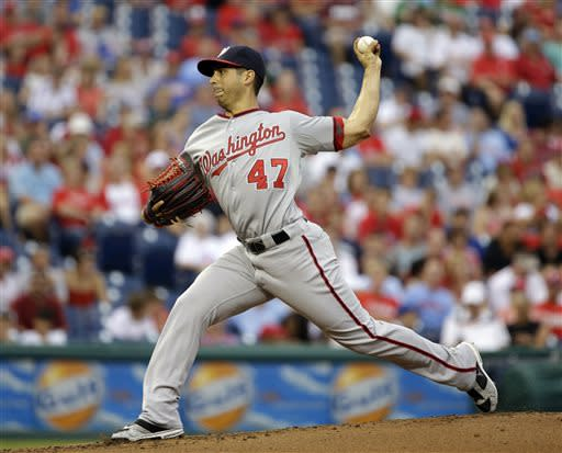 Washington Nationals' Gio Gonzalez pitches in the first inning of a baseball game against the Philadelphia Phillies, Wednesday, July 10, 2013, in Philadelphia. (AP Photo/Matt Slocum)