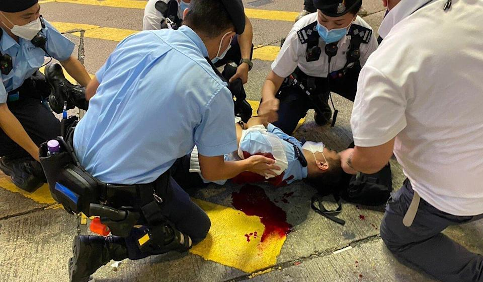 A Hong Kong police officer is treated after being stabbed late on Thursday evening. Photo: Handout