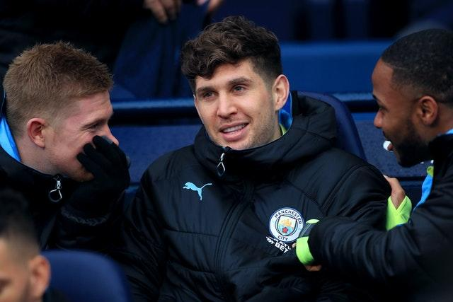 Stones, centre, has yet to feature since the resumption