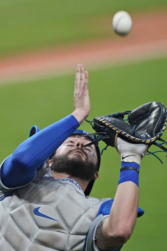Kansas City Royals' Cam Gallagher catche a foul ball hit by Cleveland Indians' Austin Hedges during the sixth inning of a baseball game Thursday, Sept. 10, 2020, in Cleveland. The Royal won 11-1. (AP Photo/Tony Dejak)