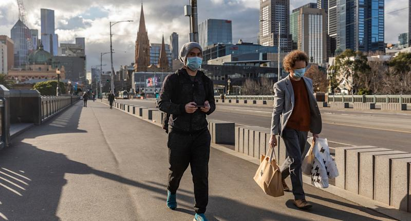 Two people wearing face masks in Melbourne.