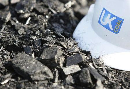 A hard hat lies on top of a coal seam at UK Coal's Cutacre surface mine near Bolton