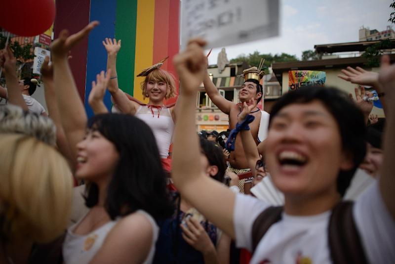 In a photo taken on June 7, 2014 members of the LGBT community take part in a Gay Pride parade in Seoul (AFP Photo/Ed Jones)