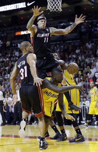 Indiana Pacers' Lance Stephenson (1) is fouled by Miami Heat's Chris Andersen (11) during the first half of an NBA basketball game in Miami, Sunday, March 10, 2013. (AP Photo/Alan Diaz)