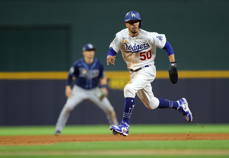 ARLINGTON, TX - OCTOBER 20: Mookie Betts #50 of the Los Angeles Dodgers steals third base in the fifth inning of Game 1 of the 2020 World Series between the Los Angeles Dodgers and the Tampa Bay Rays at Globe Life Field on Tuesday, October 20, 2020 in Arlington, Texas. (Photo by Alex Trautwig/MLB Photos via Getty Images)