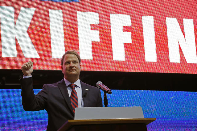 Lane Kiffin reacts to Mississippi fans as he is introduced as the new NCAA college football coach during a public introduction at The Pavilion, a multipurpose arena on the campus in Oxford, Miss., Monday, Dec. 9, 2019. Kiffin was previously, the football coach for three years at Florida Atlantic. (AP Photo/Rogelio V. Solis)