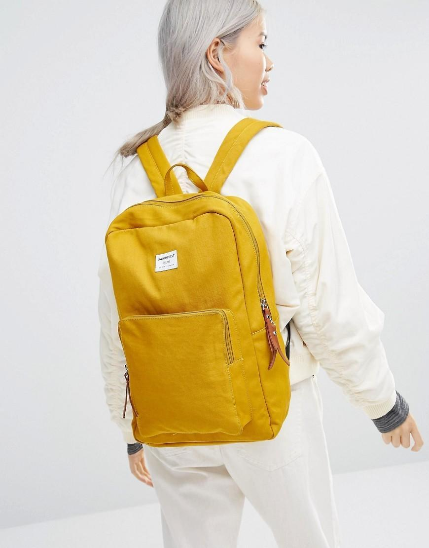 """<p><a href=""""http://www.asos.com/sandqvist/sandqvist-kim-backpack-in-yellow/prod/pgeproduct.aspx?iid=6655646&clr=Yellow&SearchQuery=yellow&pgesize=36&pge=0&totalstyles=701&gridsize=3&gridrow=4&gridcolumn=3"""" rel=""""nofollow noopener"""" target=""""_blank"""" data-ylk=""""slk:£75.00 from ASOS"""" class=""""link rapid-noclick-resp"""">£75.00 from ASOS</a><br></p>"""