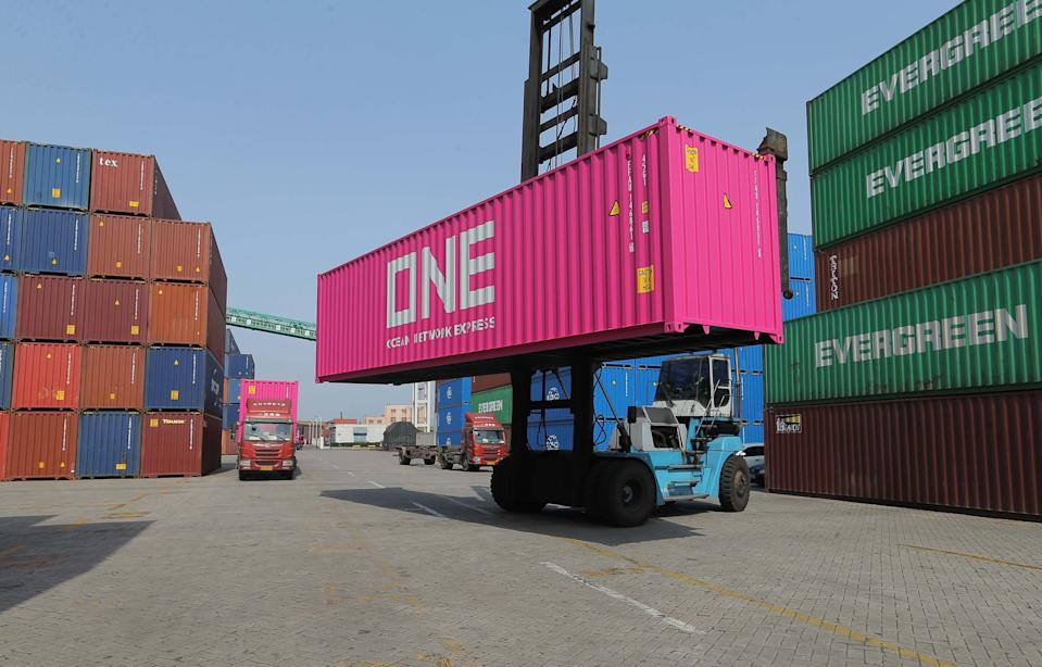 LIANYUNGANG, CHINA - JUNE 03: A worker unloads a shipping container at Lianyungang Port on June 3, 2019 in Lianyungang, Jiangsu Province of China. (Photo by Wang Jianmin/VCG)
