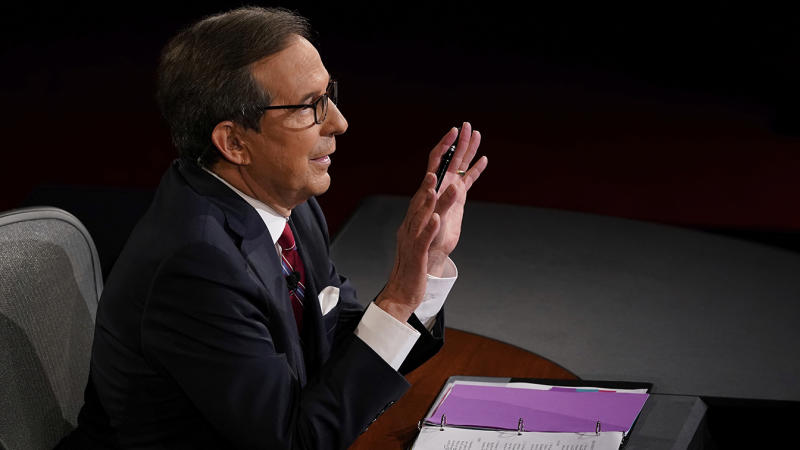 Moderator Chris Wallace of Fox News gestures toward President Donald Trump and Democratic presidential candidate former Vice President Joe Biden during the first presidential debate Tuesday, Sept. 29, 2020, at Case Western University and Cleveland Clinic, in Cleveland, Ohio. (Morry Gash, Pool via AP)