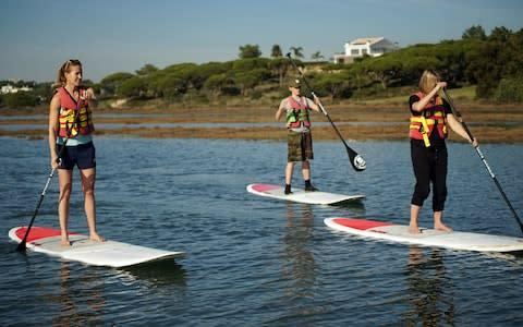 <span>Learning how to stand up paddle board</span>
