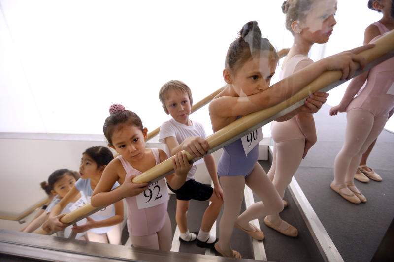 Young dancers wait to enter the studio during an audition for six-year old ballet hopefuls at the School of American Ballet, Friday, April 5, 2013 in New York. (AP Photo/Jason DeCrow)