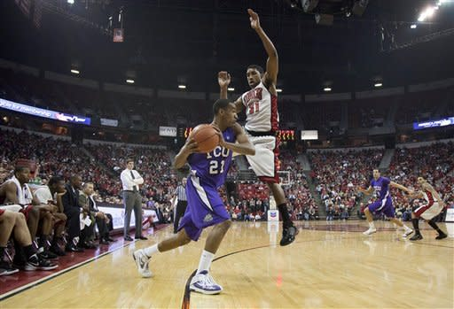 TCU's Nate Butler (21) looks to pass against UNLV's Justin Hawkins in the first half of an NCAA college basketball game, Wednesday, Jan. 18, 2012, in Las Vegas. (AP Photo/Julie Jacobson)