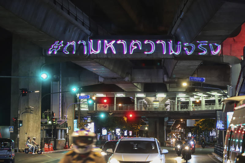 """In this Sunday, May 10, 2020. photo released by the Progressive Movement Group, shows  of the  hashtag """"#Finding Truth"""" regarding the 2010 civil protests projected on the infrastructure of the BTS Skytrain public transportation in Bangkok, Thailand, ahead of the upcoming 10th anniversary of the protests and following crackdowns. (Progressive Movement Group via AP)"""