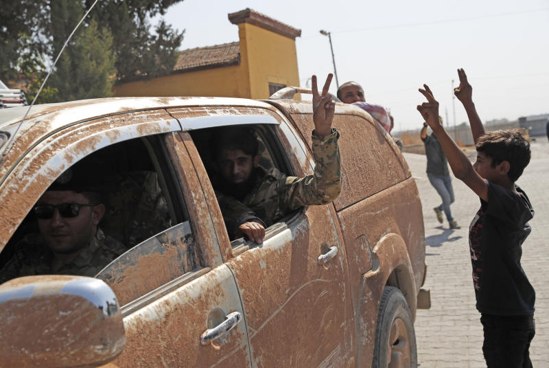 Members of Turkey-backed Syrian National Army (former FSA) flash the V-sign as they drive back to Turkey after they went in for some time on inspection according to the Turkish police entourage in the same area at the border between Turkey and Syria, in Akcakale, Sanliurfa province, southeastern Turkey, Oct. 9, 2019. (Photo: Lefteris Pitarakis/AP)
