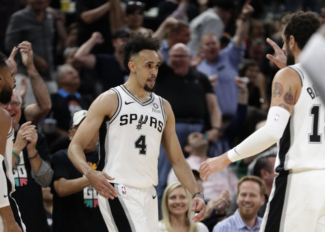 San Antonio Spurs guard Derrick White (4) celebrates a score against the Denver Nuggets with teammates during the first half of Game 3 of an NBA basketball playoff series in San Antonio, Thursday, April 18, 2019. San Antonio won 118-108. (AP Photo/Eric Gay)