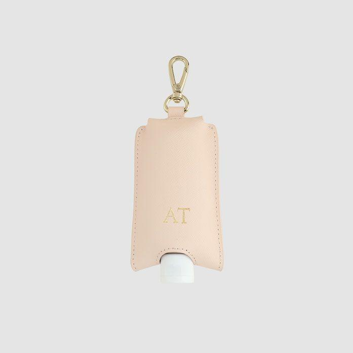 """<p><strong>The Daily Edited</strong></p><p>thedailyedited.com</p><p><strong>$50.00</strong></p><p><a href=""""https://www.thedailyedited.com/pale-pink-hand-sanitiser-holder"""" rel=""""nofollow noopener"""" target=""""_blank"""" data-ylk=""""slk:Shop Now"""" class=""""link rapid-noclick-resp"""">Shop Now</a></p><p>This is probably the chicest hand sanitizer case you'll find on the internet. </p>"""