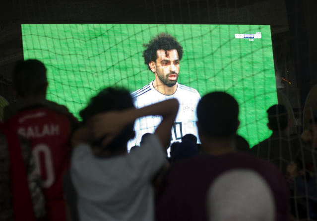 Egyptian fans watch the group A World Cup match between Egypt and Russia on a giant screen at Al Jazera Youth Club, in Cairo, Egypt, Tuesday, June 19, 2018. (AP Photo/Amr Nabil)