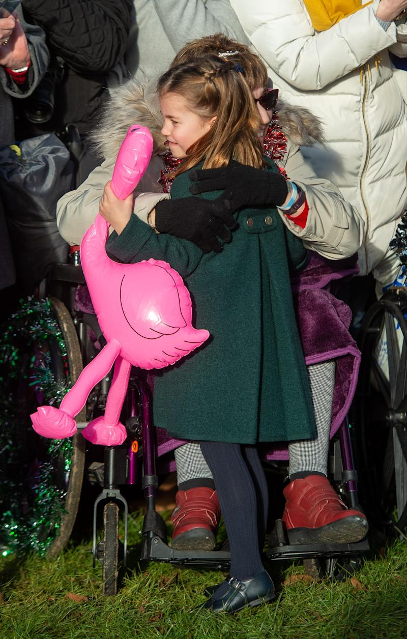 Princess Charlotte hugs a well-wisher—and her flamingo.