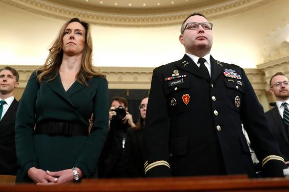 Jennifer Williams and Alexander Vindman prepare to testify at the impeachment hearings into Donald Trump (AP)