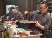 """<p>The contestants are given their <em>Chopped</em> aprons on set, but besides that, their appearance is up to them, because <a href=""""https://www.mashed.com/32044/reasons-chopped-totally-fake/"""" rel=""""nofollow noopener"""" target=""""_blank"""" data-ylk=""""slk:there are no stylists on set"""" class=""""link rapid-noclick-resp"""">there are no stylists on set</a>. Chefs are supposed to arrive for their call time ready to film.</p>"""