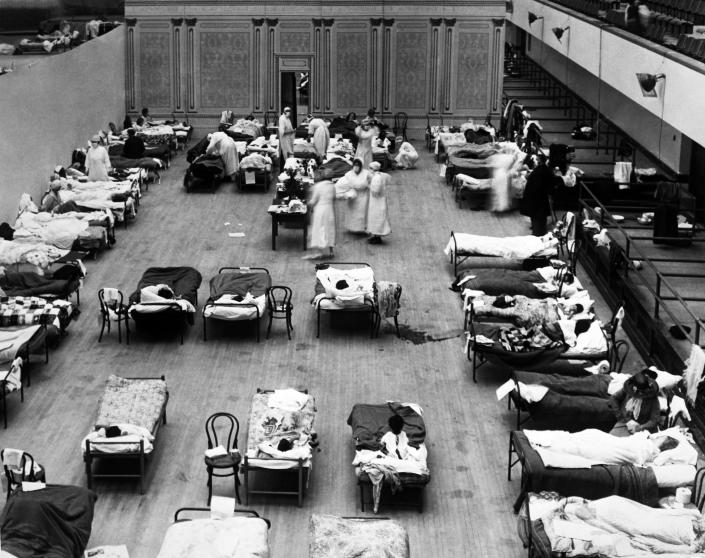 The Oakland Municipal Auditorium is used as a temporary hospital with volunteer nurses from the American Red Cross tending the sick during the influenza pandemic of 1918, Oakland, Calif., 1918. (Photo by Underwood Archives/Getty Images)