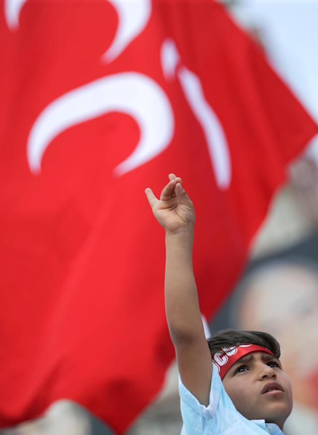 A supporter of Devlet Bahceli, leader of Nationalist Movement Party (MHP), gestures as he attends an election rally in Ankara, Turkey June 23, 2018. REUTERS/Stoyan Nenov TPX IMAGES OF THE DAY