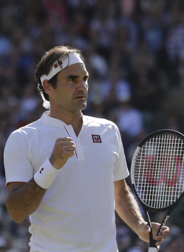 Switzerland's Roger Federer celebrates winning a point in the fifth set of his men's quarterfinals match against Kevin Anderson of South Africa at the Wimbledon Tennis Championships, in London, Wednesday July 11, 2018. (AP Photo/Ben Curtis)