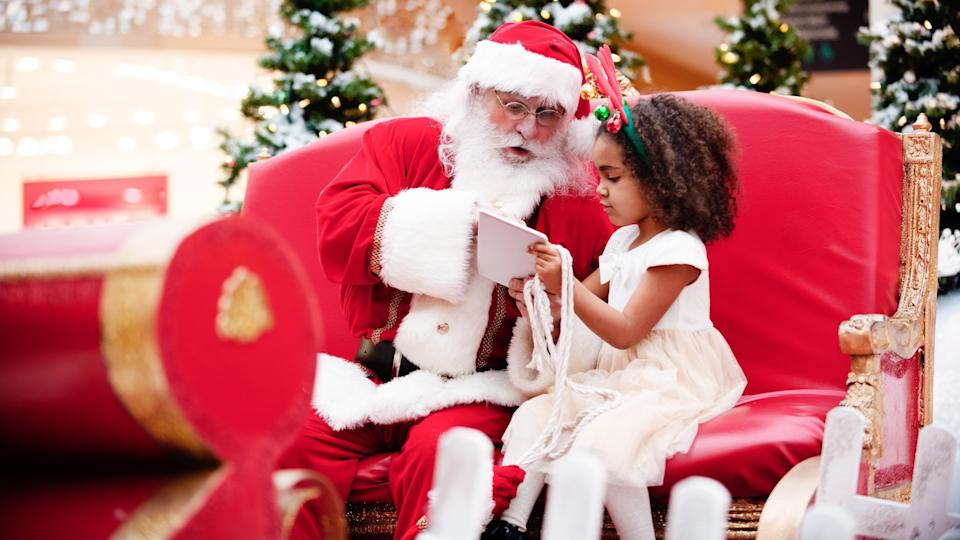 Shopping Christmas with family and Santa Claus at Shopping Mall stock photo