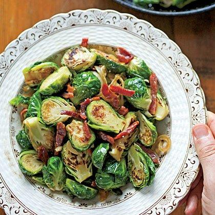 """<p>Easy seared Brussels sprouts get salty-sweet undertones from crispy ham and long-cooked onions.</p> <p><a href=""""https://www.myrecipes.com/recipe/brussels-sprouts-ham-onions"""">Brussels Sprouts with Ham and Caramelized Onions Recipe</a></p>"""