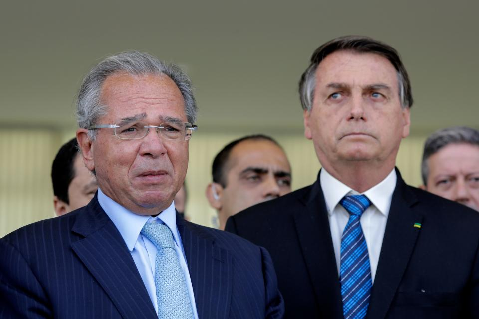 Brazilian President Jair Bolsonaro (R) and Brazilian Economy Minister Paulo Guedes (L) deliver a statement on financial aid for vulnerable Brazilians amid the COVID-19 pandemic, at Planalto Palace, in Brasilia, on September 1, 2020. - Brazil announced a reduction of 9.1% in the gross domestic product. (Photo by Sergio Lima / AFP) (Photo by SERGIO LIMA/AFP via Getty Images)