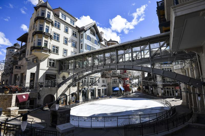 This Tuesday, March 24, 2020 photo shows an empty ice skating rink at the base in Vail, Colo., after Vail Ski Resort closed for the season amid the COVID-19 pandemic. Ski resorts across the West that were shut down amid coronavirus fears are grappling with an economic blow at a time they would normally be welcoming hordes of spring break revelers.  (AP Photo/Michael Ciaglo)