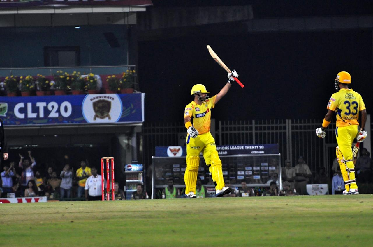 Chennai Super Kings batsman Suresh Raina celebrates his half century against Hyderabad Sunrisers at Champions League Twenty-20 Match at Jharkhand State Cricket Association (JSCA) International Cricket Stadium in Ranchi on Sept. 26, 2013. (Photo: IANS)