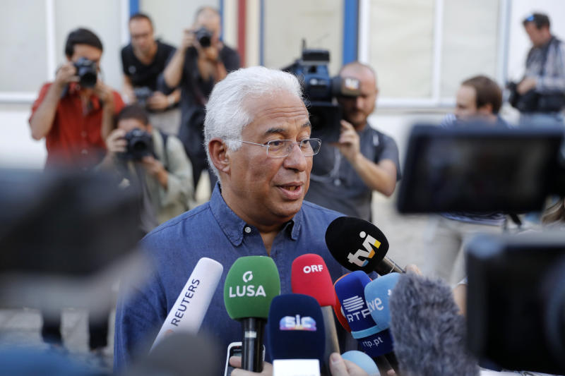 Portuguese Prime Minister and Socialist Party leader Antonio Costa talks to journalists outside a polling station after voting in Lisbon Sunday, Oct. 6, 2019. Portugal is holding a general election Sunday in which voters will choose members of the next Portuguese parliament. (AP Photo/Armando Franca)