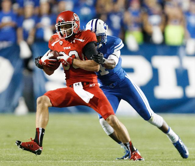 Utah wide receiver Sean Fitzgerald (83) is pulled down by Brigham Young defensive back Robertson Daniel (4) in the first quarter of an NCAA football game, Saturday, Sept. 21, 2013 in Provo, Utah. (AP Photo/The Salt Lake Tribune, Trent Nelson)