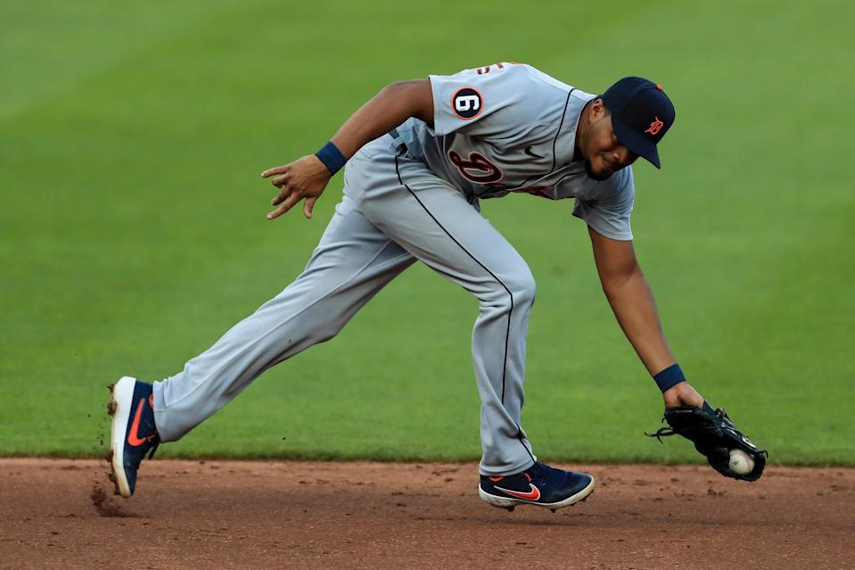 Tigers third baseman Jeimer Candelario fields the ball before throwing out Reds third baseman Eugenio Suarez in the third inning at Great American Ballpark in Cincinnati, Friday, July 24, 2020.