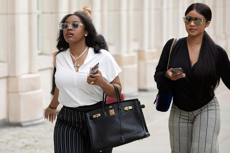Azriel Clary, left, and Joycelyn Savage, right, two women who say they are R. Kelly's live-in girlfriends, arrive at Brooklyn federal court for his arraignment on sex-crime charges, Aug. 2, 2019 in New York.