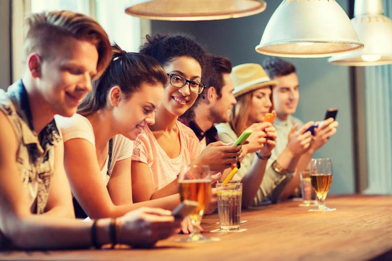 A pub in Wales is offering a discount if customers agree to lock away their phones: Shutterstock / Syda Productions