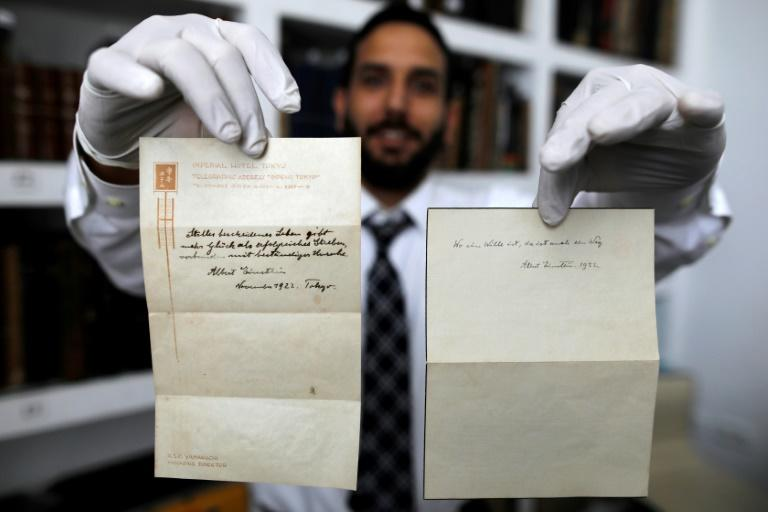 Gal Winner, owner and manager of the Winner's auction house in Jerusalem, on October 19, 2017 displays two notes written by Albert Einstein in 1922 on hotel stationary from the Imperial Hotel in Tokyo, Japan