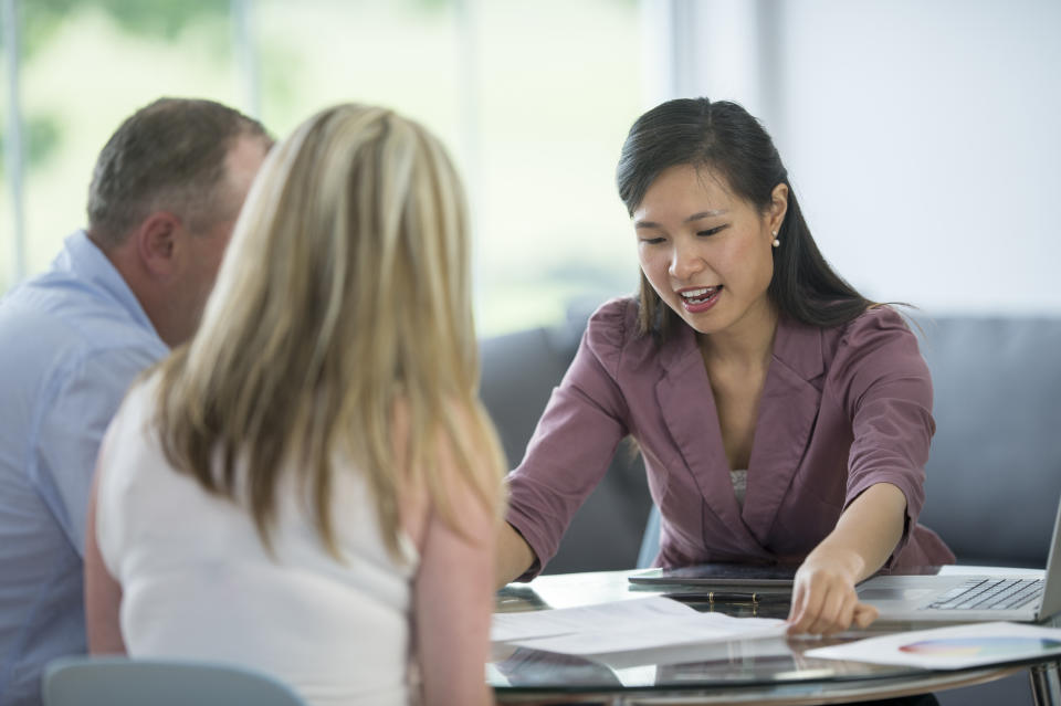 A husband and wife are seeking financial advice from a financial planners. They are discussing their retirement plan, loans, mortgages, 401K, and budget.