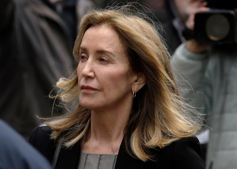 Felicity Huffman arrives at federal court Monday, May 13, 2019, in Boston, where she is scheduled to plead guilty to charges in a nationwide college admissions bribery scandal.