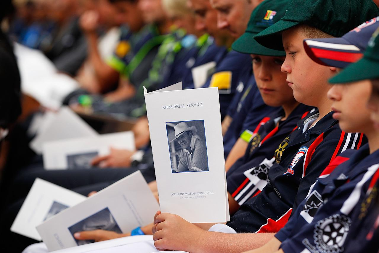 SYDNEY, AUSTRALIA - JANUARY 20:  Young cricketers hold a memorial service booklet during the Tony Greig memorial service at Sydney Cricket Ground on January 20, 2013 in Sydney, Australia.  (Photo by Brendon Thorne/Getty Images)