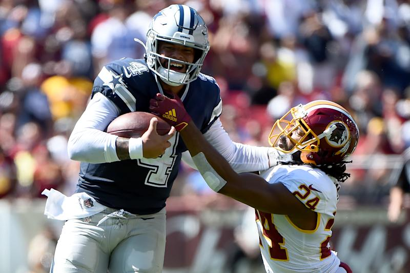 LANDOVER, MD - SEPTEMBER 15: Dak Prescott #4 of the Dallas Cowboys runs in front of Josh Norman #24 of the Washington Redskins during the first half at FedExField on September 15, 2019 in Landover, Maryland. (Photo by Will Newton/Getty Images)