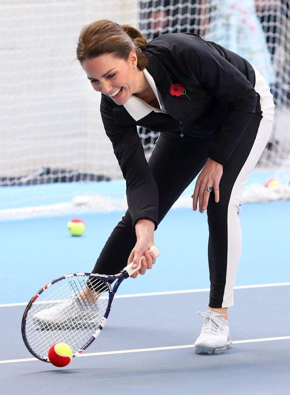 <p>While rallying at the National Tennis Centre, Kate sported a chic black and white look. </p>